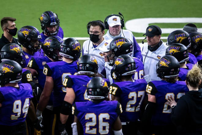 Northern Iowa head coach Mark Farley talks with players in a timeout during a NCAA college Missouri Valley Football Conference game against South Dakota State, Friday, Feb. 19, 2021, at the UNI-Dome in Cedar Falls, Iowa.