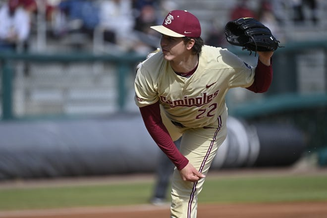 Florida State freshman pitcher Carson Montgomery (22) thows a pitch during his debut vs. the University of North Florida Ospreys at Dick Howser Stadium in Tallahassee, FL., on Feb. 21, 2021.