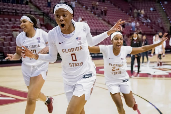 Florida State players Kourtney Weber (left), Bianca Jackson (center) and Tiana England (right) celebrate the squad's 68-59 upset victory over No. 2 Louisville at the Donald L. Tucker Civic Center in Tallahassee, FL., on Feb. 21, 2021.