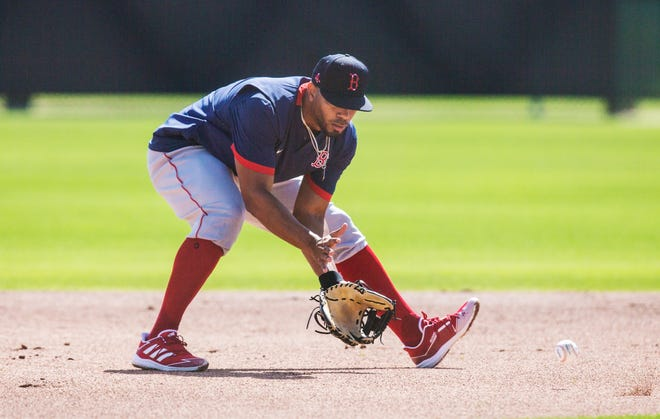 Xander Bogaerts, the shortstop for the Boston Red Sox fields ground balls at Jet Blue Park in Fort Myers on Feb. 22. He is working his way back from a sore shoulder.