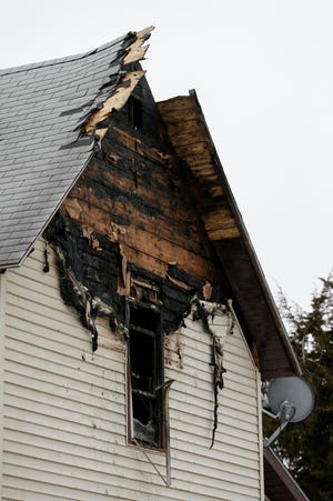 Damage is seen to the second floor of a Hartford Street home, Monday, Feb. 22, 2021 in Lafayette. A woman was found dead by firefighters inside after a Saturday morning fire.
