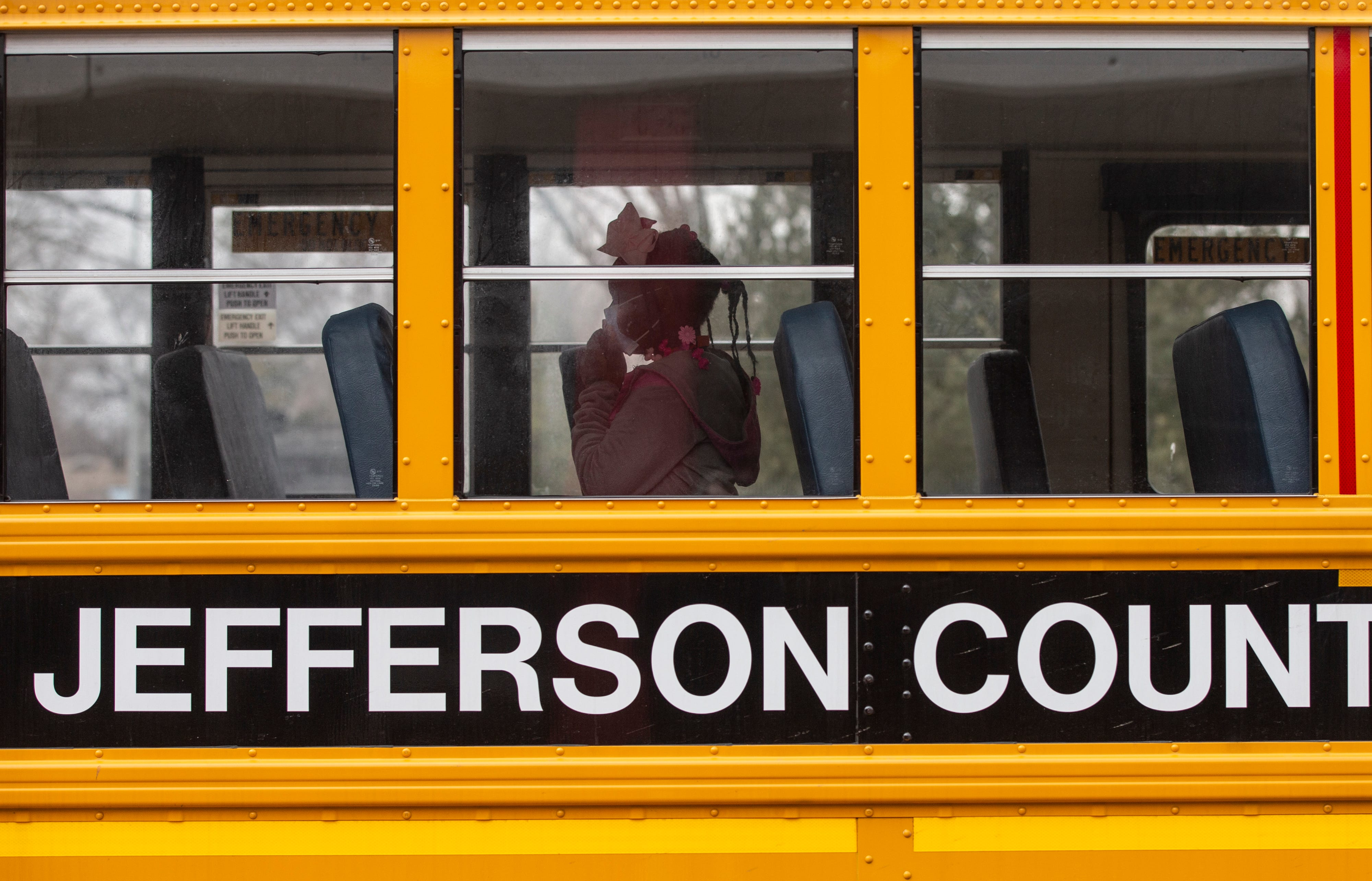 Jefferson County Public Schools demonstrated how the return to in-person learning would be handled in the pandemic. Gutermuth Elementary third grade student Kenya Hannah wears her mask as she boards a school bus on Feb. 22, 2021.