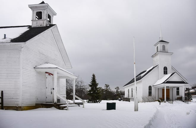 The 1883 Randall Schoolhouse, left, and the Village Church, seen Monday, Feb. 22, 2021, at the Meridian Historical Village in Okemos.