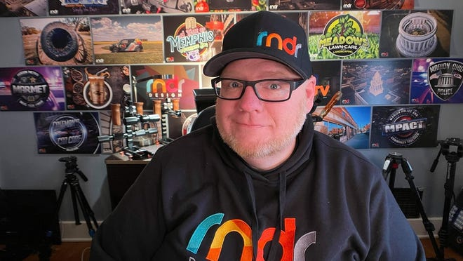 Michael Bodine II inside his home studio where he uses his passion for graphic design to create videos at Rndr Design and CANTV-Community Advertising Network.