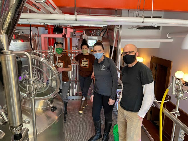 Indeed Brewing and the Milwaukee County Historical Society collaborate on the Lady Elgin Foreign Extra Stout. From left to right: Indeed Head Brewer Patrick Nickelson, Indeed Assistant Brewer Jenny Engel, MCHS Executive Director Mame McCully, and MCHS Curator Ben Barbera.