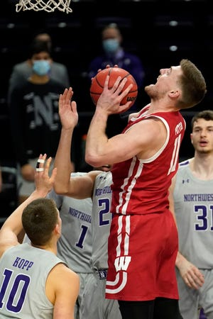 Wisconsin forward Micah Potter goes up for a shot against Northwestern.