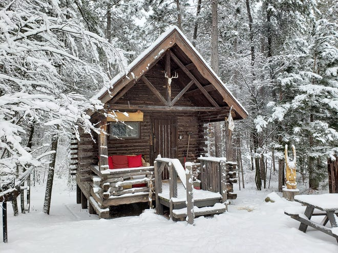 Snow surrounds the Viking Cabin outside Marquette in Michigan's Upper Peninsula. The small cabin has electricity, a kitchenette and sleeps two in a loft bedroom.