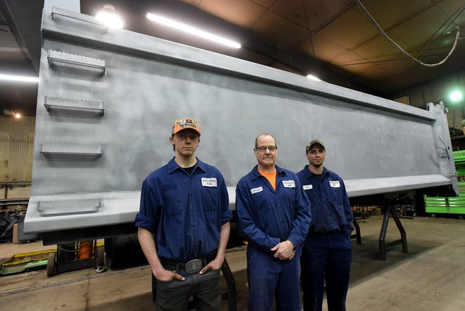 Dennis Conard (center), owner of Affordable Fab & Truck Repair, with employees Nick Buchert and Joey Woosley in front of a trailer under repair. The Utica company specializes in a wide variety of welding and fabrication as well as aluminum repair.