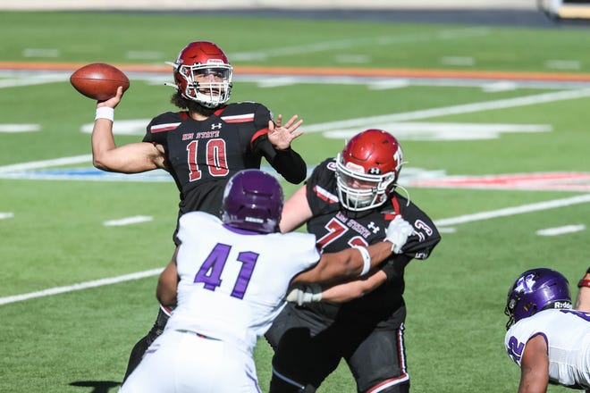 Jonah Johnson (10) passes as the New Mexico State Aggies face off against the Tarleton State Texans at the Sun Bowl in El Paso on Sunday, Feb. 21, 2021.