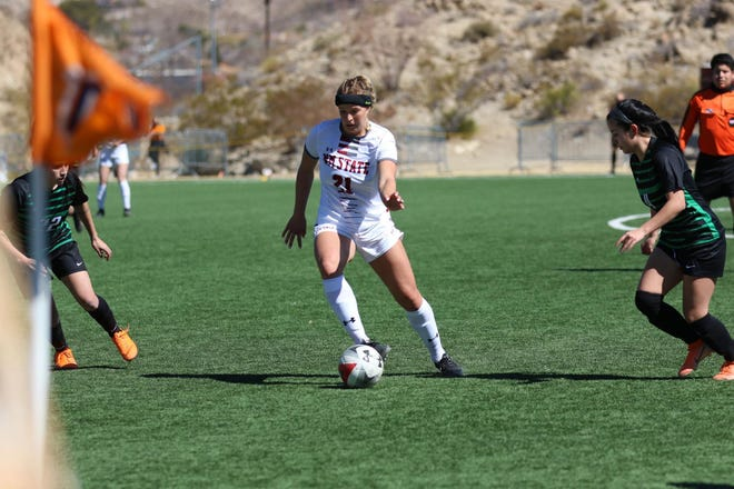 Junior midfielder Grace Olson gathers a pass during New Mexico State's 6-1 win over Chicago State on Feb. 22, 2021, in El Paso, Texas.