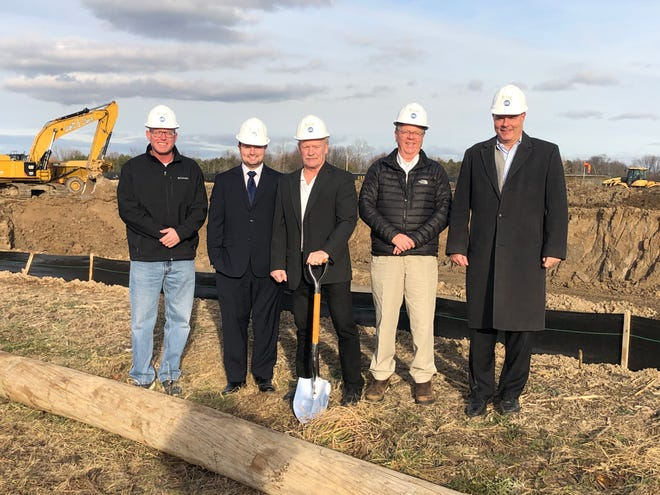 St. Clair County Board of Commissioners Chairman Jeff Bohm, St. Clair Superintendent Warren Rothe, St. Clair Mayor Bill Cedar, Economic Development Alliance of St. Clair County President Edward Brooks and EDA CEO Dan Casey at the future Magna Electric Vehicle Structures facility site in St. Clair in December 2020.