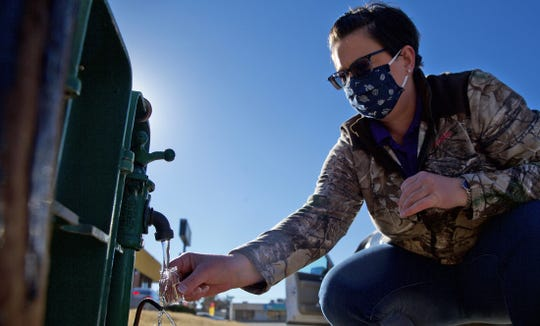 Courtney Lemons with the city of San Angelo takes a water sample at a testing station on Knickerbocker Rd. on Monday, Feb. 22, 2021.