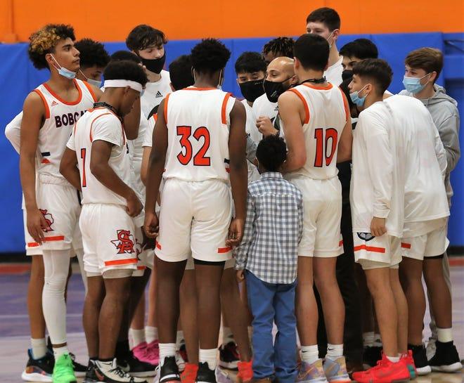 The San Angelo Central High School boys basketball team listens to first-year head coach C.J. Villegas during a game against Odessa Permian earlier in the 2020-21 season.