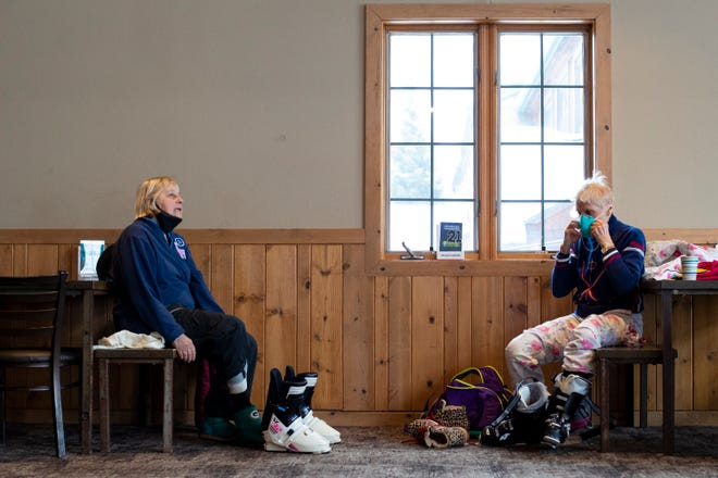 Kay Kuester Doran, 85, left, and Mary-Beth Kuester, 82, put on their gear at Granite Peak Ski Area. They both have been skiing all over the world. Mary-Beth bought her ski suit in France.