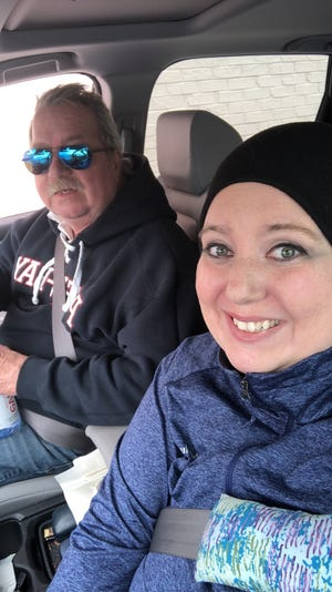 Tori Geib with her father, Victor Geib, on their way to Cleveland, Ohio for her clinical trial in February 2021.