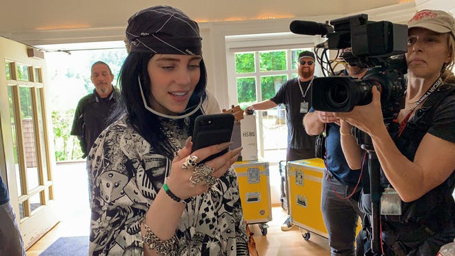 """Billie Eilish in a scene from her new Apple TV+ documentary """"Billie Eilish: The World's a Little Blurry,"""" streaming Friday."""