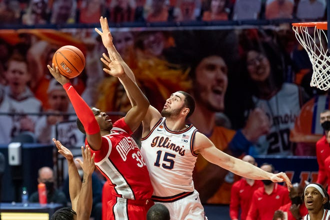 Ohio State Buckeyes forward E.J. Liddell (32) goes up for a shot against Illinois Fighting Illini forward Giorgi Bezhanishvili (15) during the second half at the State Farm Center.