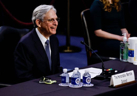 Judge Merrick Garland reacts as he testifies before a Senate Judiciary Committee hearing on his nomination to be US Attorney General on Capitol Hill in Washington, DC on Feb. 22, 2021.