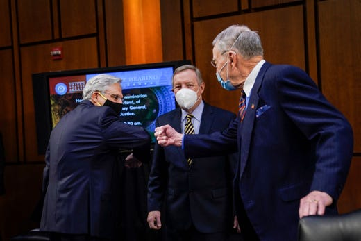 (L-R) Attorney General nominee Merrick Garland is greeted by committee chairman Sen. Dick Durbin (D-IL) and ranking member Sen. Chuck Grassley (R-IA) as he arrives at the start of a Senate Judiciary Committee hearing on the nomination of Judge Merrick Garland to be US Attorney General on Capitol Hill in Washington, DC on Feb. 22, 2021.