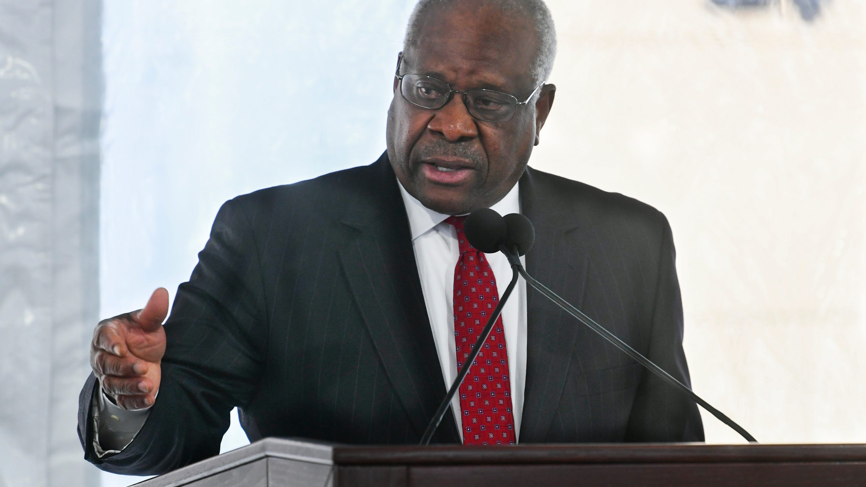 Dissent by Justice Thomas in election case draws fire for revisiting baseless Trump fraud claims