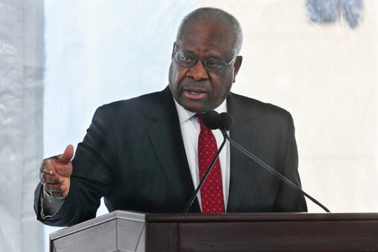 Supreme Court Justice Clarence Thomas delivers a keynote speech during a dedication of Georgia new Nathan Deal Judicial Center Tuesday, Feb. 11, 2020, in Atlanta.