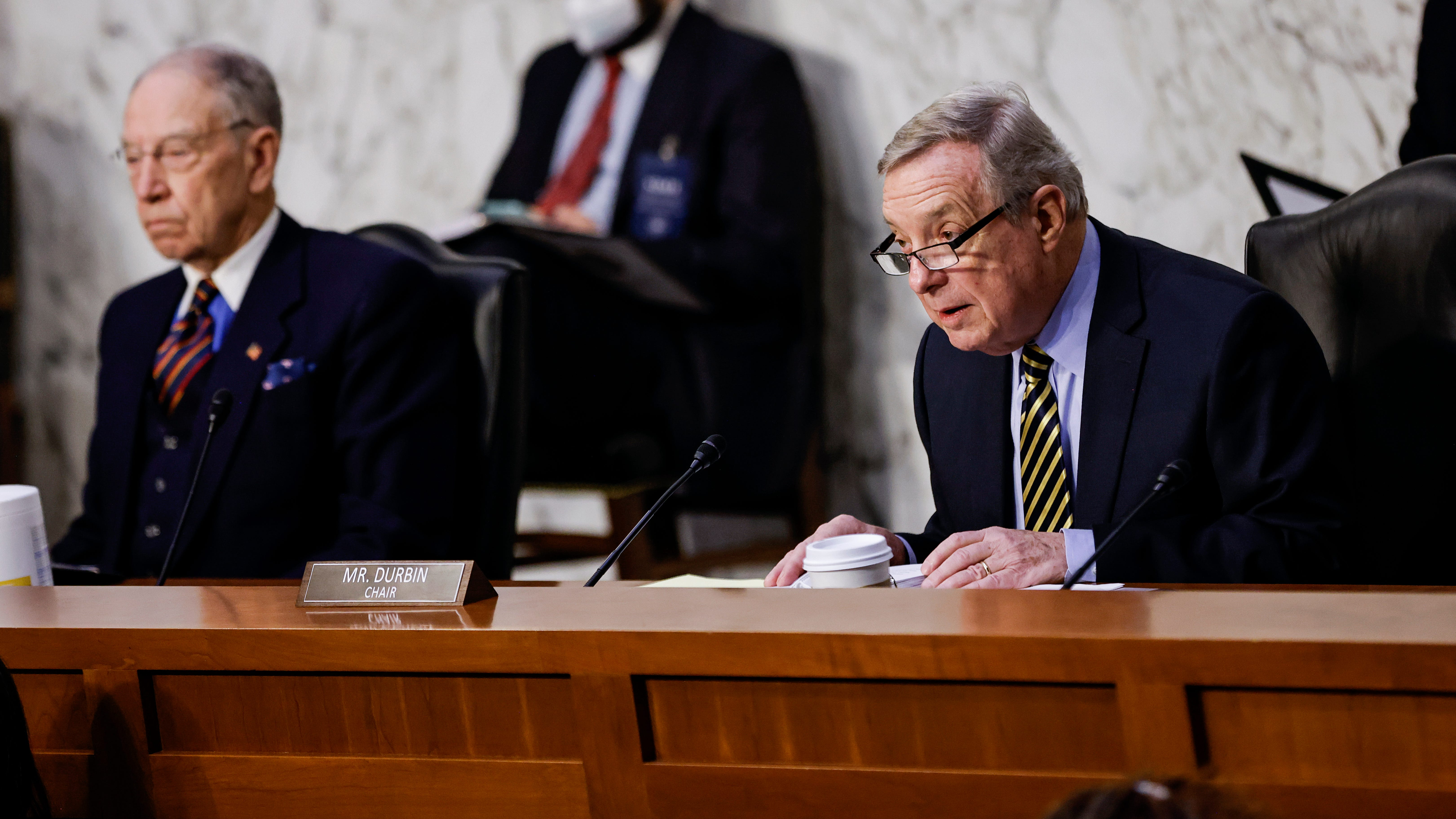 """Senate Judiciary Committee Chairman Dick Durbin, D-Ill., right, said the country came close to a """"constitutional crisis."""" Sen. Chuck Grassley, R-Iowa, disagreed with """"the left's claims that the former president weaponized the Justice Department to alter the election results."""""""