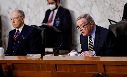 Senate Judiciary Committee Chairman Sen. Dick Durbin, D-Ill., right, is seated next to Sen. Chuck Grassley, R-Iowa, prior to presiding over a Senate Judiciary Committee hearing on the nomination of Judge Merrick Garland to be U.S. Attorney General, Feb. 22, 2021 on Capitol Hill in Washington.
