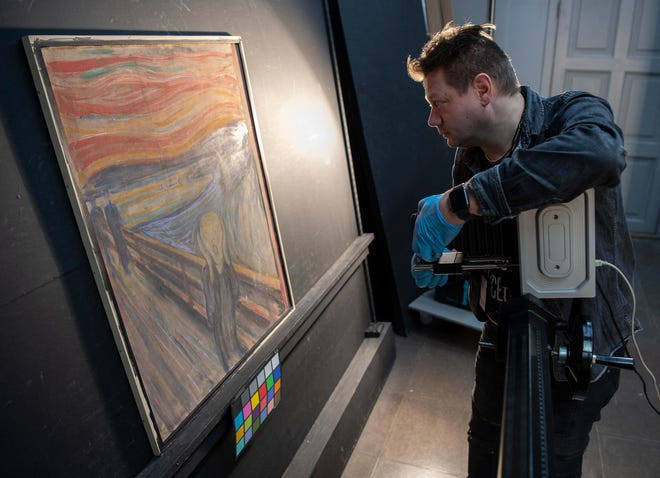 "A curator at the National Museum of Norway uses an infrared scanner to reveal author of a scribbled sentence on Edvard Munch's 1893 painting ""The Scream"" in Oslo."