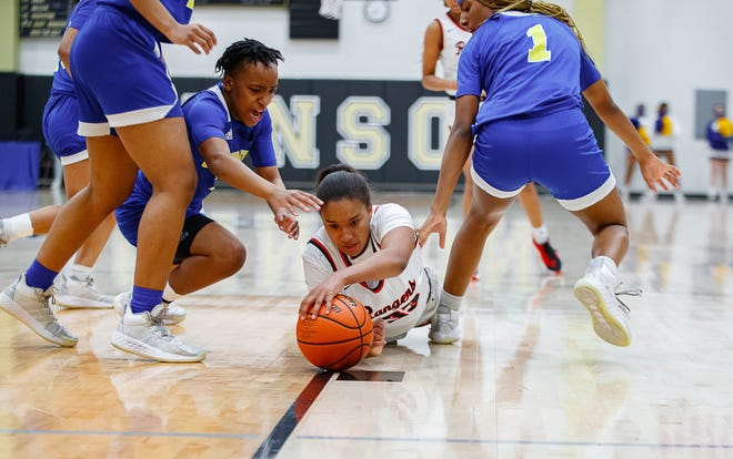 Vista Ridge Rangers guard Aniyah Burke, center, reaches for the loose ball against the Clemens Buffaloes during the first period at the Class 6A area-round girls basketball playoff game Monday at Johnson High School.