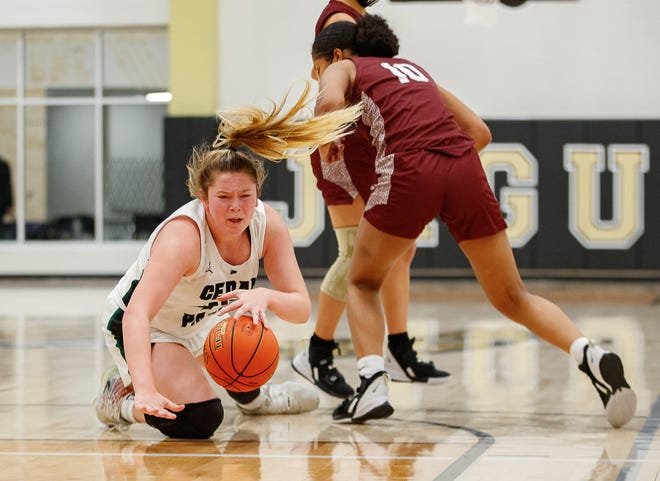 Cedar Park Timberwolves center Shelby Hayes dives for the loose ball and draws a foul against San Antonio Highlands during the third period at the Class 5A area-round girls basketball playoff on Monday at Johnson High School in Hays County.
