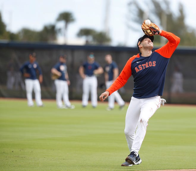 Houston Astros shortstop Carlos Correa catches a pop out during spring training baseball in West Palm Beach, Fla., on Monday. The Astros avoided arbitration with Correa by signing him to a one-year, $11.7 million contract.
