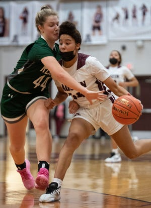 San Antonio Reagan's Miranda Noach, left, tries to steal the ball away from Austin High's Aubrey Reid during their second-round game in the Class 6A playoffs Monday at Austin High School.