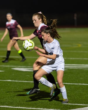 McNeil's Tristyn Kattawar, front, scored a goal as McNeil upset state-ranked Westwood in a District 25-6A girls soccer match.