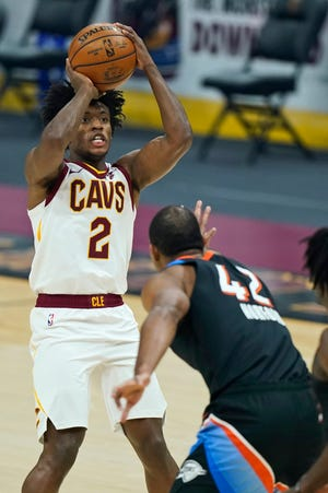 Cavaliers guard Collin Sexton (2) says the team remains in good spirits despite a 10-game losing streak but needs to start winning games right now. [Tony Dejak/Associated Press]