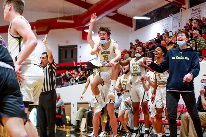Amarillo's Brendan Hausen (15) jumps up to celebrate a teammate's made basket against Abilene Wylie during the UIL 5A Bi-District Championship on Monday at Slaton High School. [John Moore/for Amarillo Globe-News]