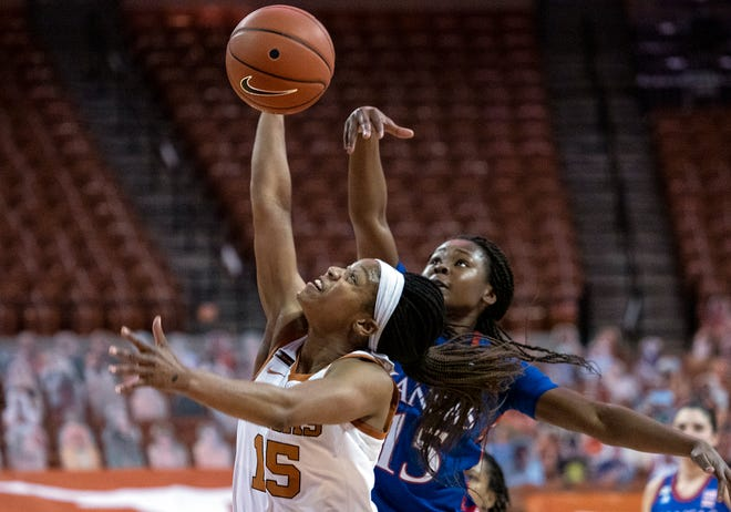 Texas point guard Kyra Lambert has a shot blocked by Kansas' Zakiyah Franklin during the Longhorns' 79-72 win in Austin on Jan. 14. Texas has won 16 of the last 17 meetings in the series.