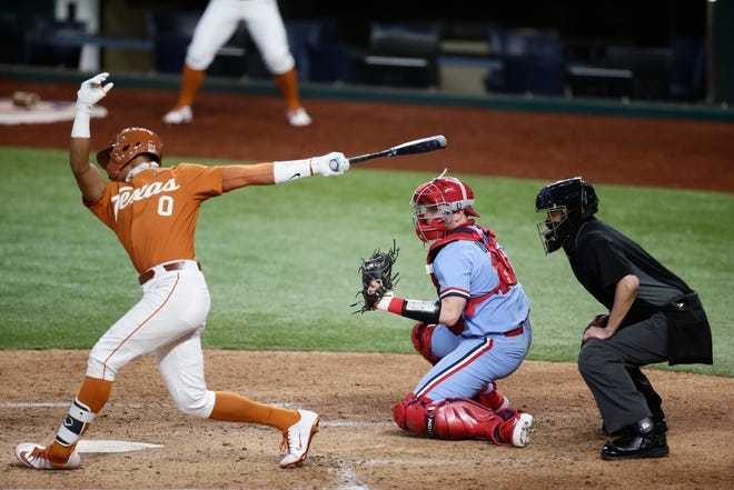 Texas' Trey Faltine swings and misses at a pitch during the Longhorns' 8-1 loss to Ole Miss on Monday night at Globe Life Field in Arlington. Texas, ranked ninth nationally, went 0-3 in the College Baseball Showdown.