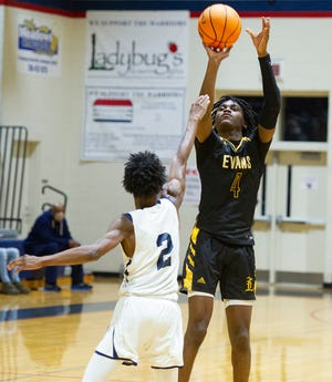 Rashad King of Evans attempts a shot as Julius Brown of Grovetown defends at the high school basketball game between Evans and Grovetown on January 22, 2021 in Grovetown, Ga. [MIKE ADAMS FOR THE AUGUSTA CHRONICLE]