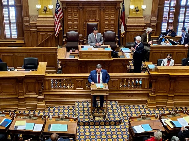 State Sen. Larry Walker III, R-Perry, urges support for his bill on absentee voter ID requirements from the Georgia Senate floor on Feb. 23.