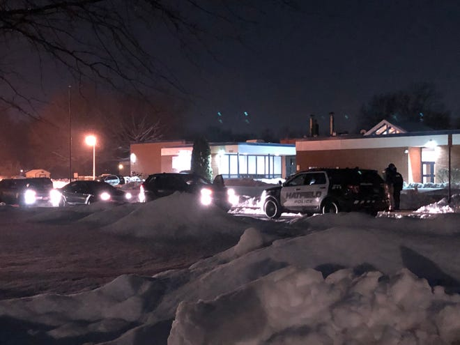 Police cars line the front of Oak Park Elementary School in Hatfield Monday night. Hatfield police said two minors were stabbed near a playground there, and the person responsible, another minor, has been taken into custody.