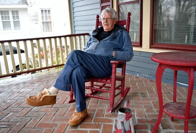 Port Norris resident David Brown, 74, sits on his porch on a frigid Monday afternoon.