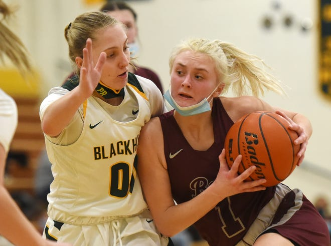 Blackhawk's Piper Romigh guards Beaver's Emma Pavelek during Monday night's game at Blackhawk High School.  The Bobcats won the game 34-32.