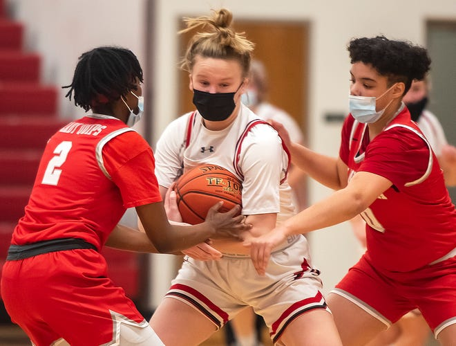 Sewickley Academy's Bre Warner is surrounded by Aliquippa's Angel Henry, left, and Amaya Walker during their game Monday at Sewickley Academy.