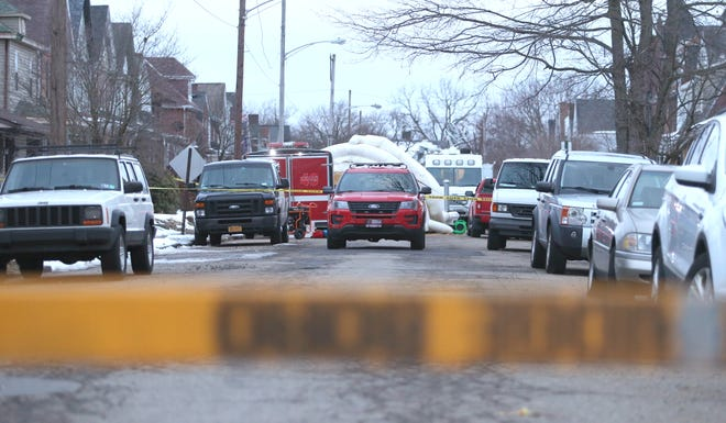 An Ambridge Fire Department squad car is seen last month blocking the scene of a fatal double-shooting on the 900 block of Maplewood Avenue in Ambridge.