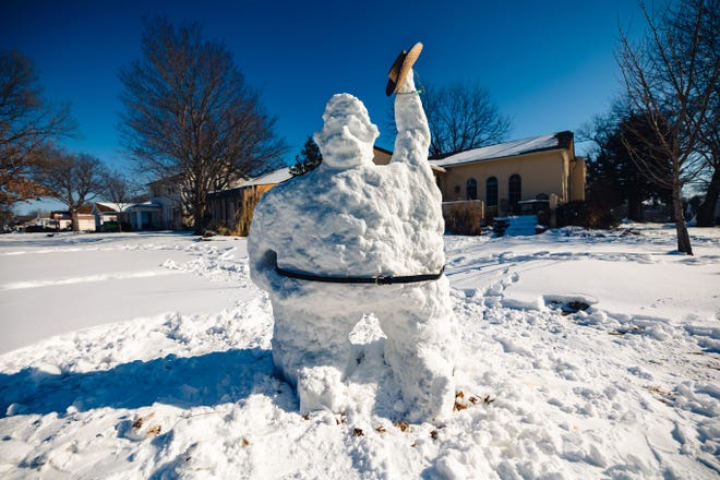Just last Friday, this snow cowboy towering over six feet high waved to passersby along 14th Street.