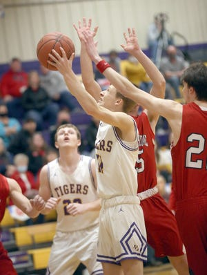 Pilot Grove senior Hayden Krumm powers up for two of his game-high 28 points Monday night against Prairie Home in the opening round of the Class 1 District 9 Tournament at Pilot Grove. The Tigers wound up winning over the Panthers 71-52.