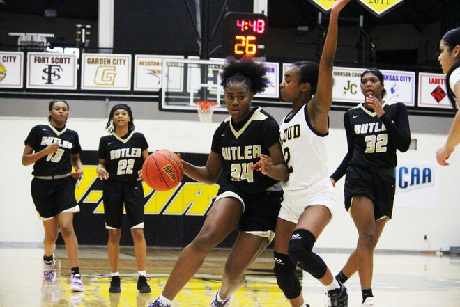 Butler's Syncere Harrod (34) races down the court as she is guarded by Cloud County's Sydni Keys (2) on Monday, Feb. 22 in Concordia, Kansas. Harrod scored four points in the 86-57 win over Cloud County.