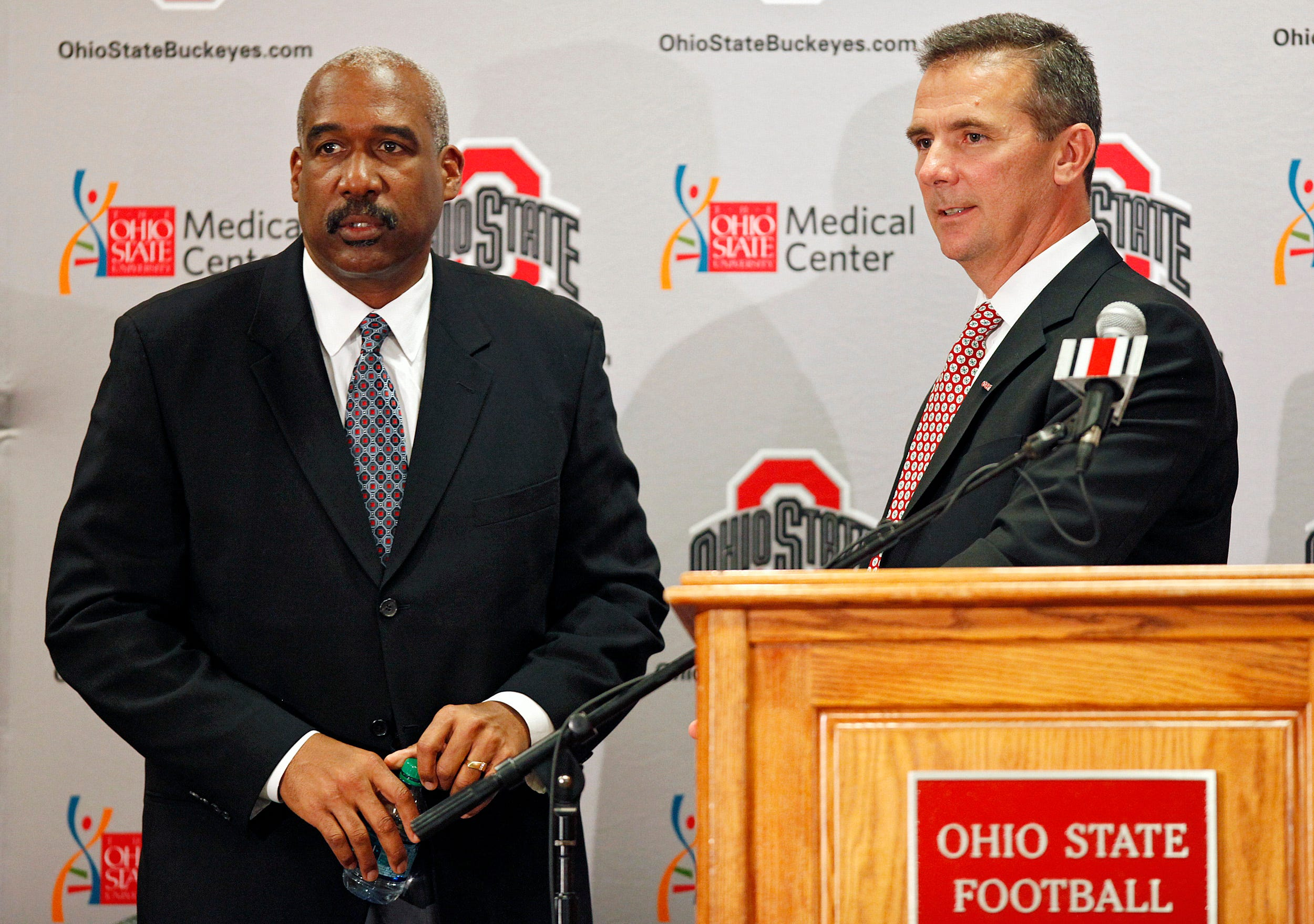 Athletic director Gene Smith and Urban Meyer during a press conference at the Fawcett Center on the campus of Ohio State in Columbus Ohio, November 28, 2011,