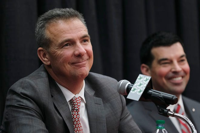 Urban Meyer, seen here with successor Ryan Day, is a proponent of the new name, image and likeness rules, though he has some concerns.