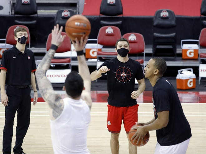 Ohio State student manager Mike Mastroianni, in red shorts, prepares to grab a rebound during a shootaround before a game against Indiana on Feb. 13.